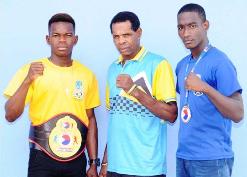 Image: (L-R) Kareem Boyce 60 kg champion, Conrad Frederick - National Boxing Coach and silver medalist Nathan Ferrari. (PHOTO: DP).