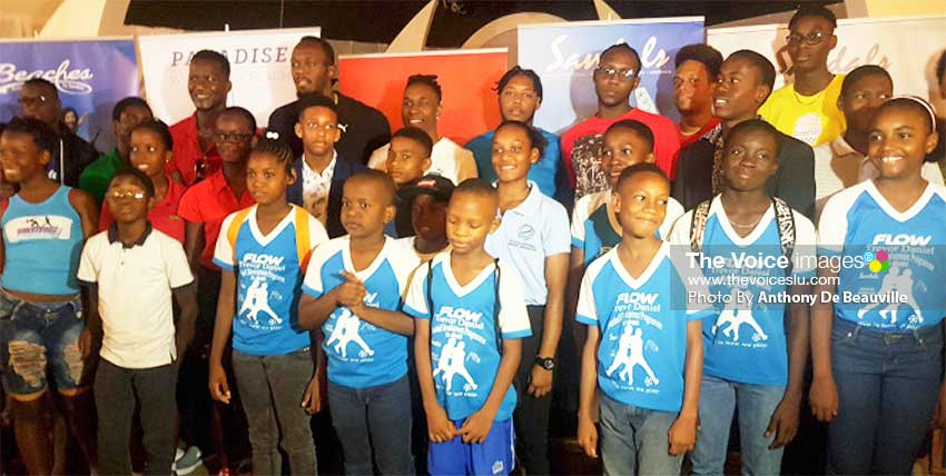 Image: Saint Lucia's young and aspiring sports personalities with Daren Sammy, Usain Bolt and Dwayne Bravo . PHOTO: Anthony De Beauville)