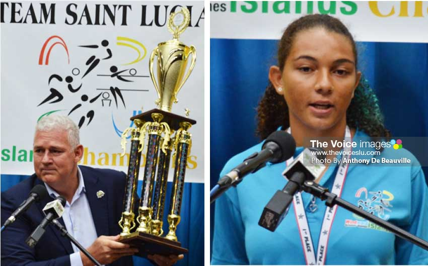 """Image: (L-R) Prime Minister Allen Chastanet says """"This is the trophy you should be proud about""""; three year WISG volleyball player Matilda Angeloni. (Photo: Anthony De Beauville)"""