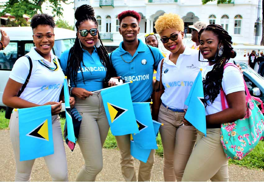 Image: Some of the bright faces representing Saint Lucia in Trinidad.