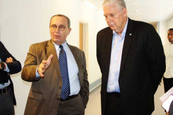 iMAGE: European Union Commission Director General for International Cooperation and Development, Stefano Manservisi, with Prime Minister Allen Chastanet during the walk through at Owen King.