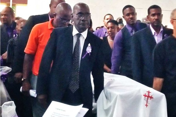 Image of media personality Harold George being laid to rest