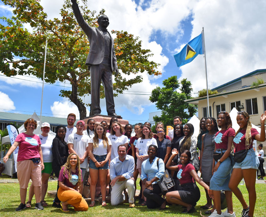 Image: Marine Science students (centre), with Geography and Psychology students; British High Commissioner, Steve McCready and Caribbean Elective representatives Harry Spear and Matt Barry at Constitution Park, Castries.