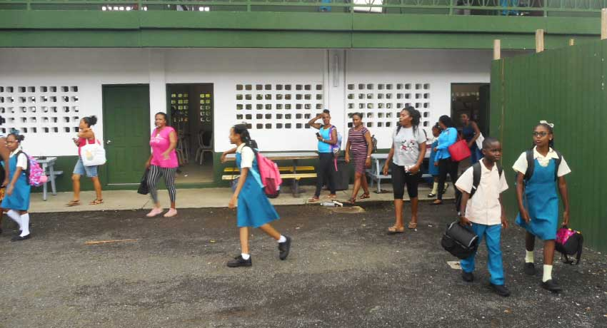 Image of parents and students leaving the school.