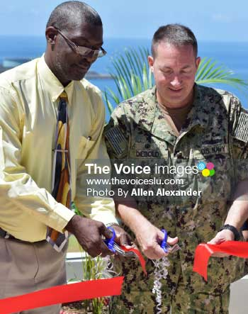Image of ribbon cutting ceremony for the opening of the USNS Comfort humanitarian effort. Felix St Hill (left) Brian Diebold (right). [Photo: Allen Alexander]
