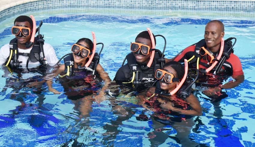 Image: Students with Dive Instructor Simeon Medard (far right).