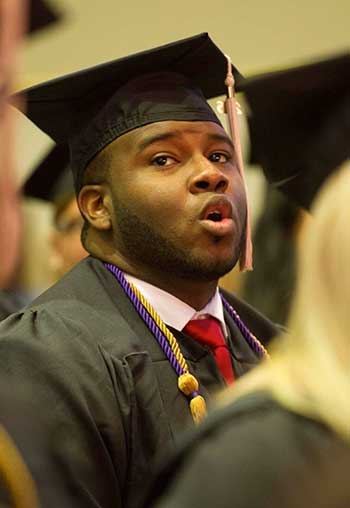 Image of Botham Jean singing lustily during his graduation ceremony