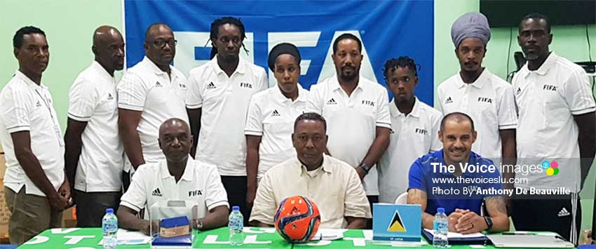 Image: (Left-right (FR) Cess Pood - SLFA Technical Director, Lyndon Cooper - SLFA President, Madjer Saraiva - FIFA Instructor; (BR) Course participants. (PHOTO: Anthony De Beauville)