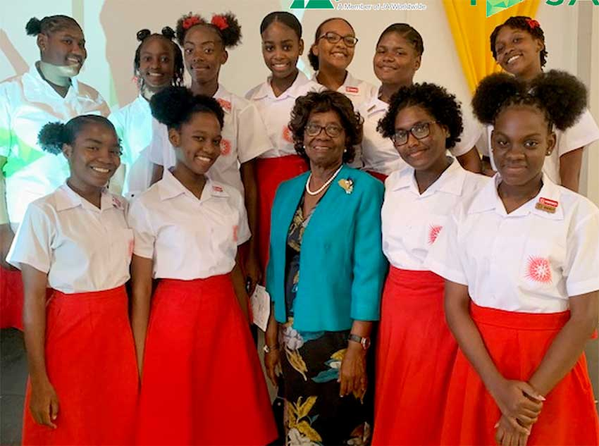 Image: Patron of Junior Achievement Her Excellency Dame Pearlette Louisy with CCSS students.