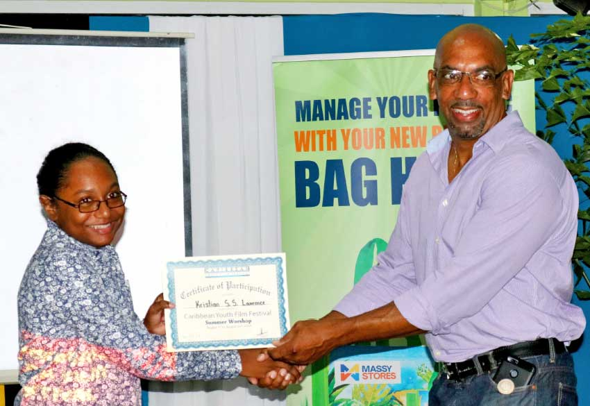 Image of Kristian Lawrence receiving her certificate of participation.