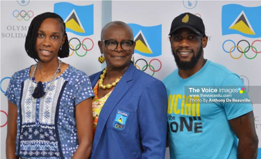 Image: (L-R) Gold medal winner Levern Spencer, SLOC President Fortuna Belrose and bronze medal winner Albert Reynolds. (Photo: Anthony De Beauville)