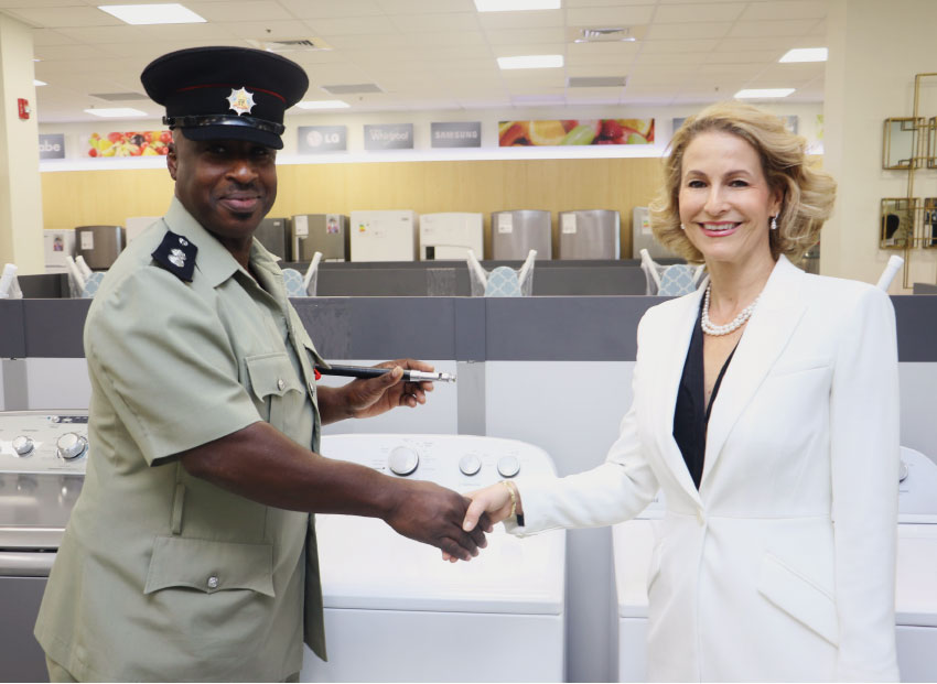Image: Make It Happen's Raquel Duboulay Chastanet makes donations of washing machines to various police stations island-wide.