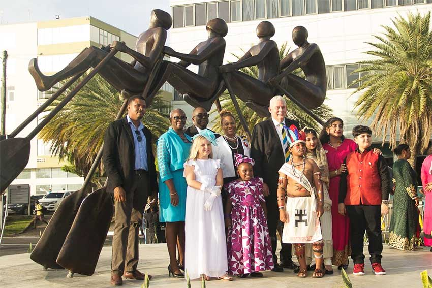 """Image of Sculptor Jallim Eudovic with Government representatives and other participants in the unveiling of the """"All In"""" Monument on the Castries Waterfront."""