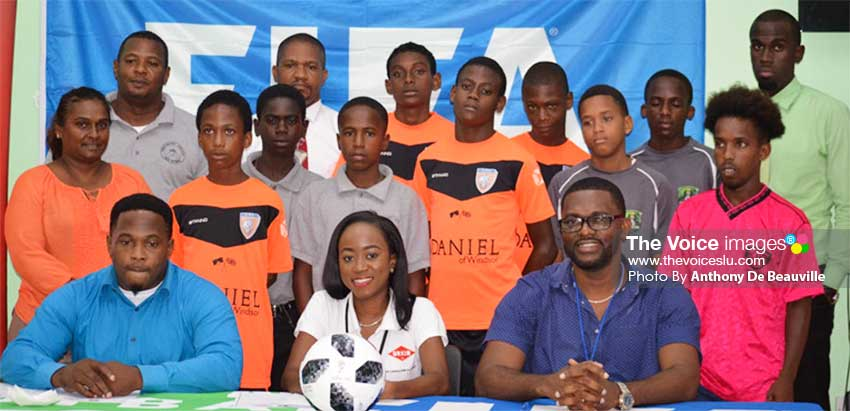 Image: (Front Row) A photo moment for GIFL President Shane Paul, Guardsman Saint Lucia Limited representative Pauline Francis,CAP D: GIFL Vice President Charde Desir; (Back Row) coaches, managers and players from the various teams. (PHOTo: Anthony De Beauville)