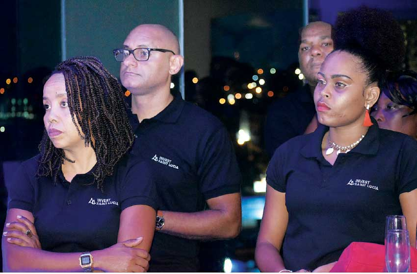 Image of staff of ISL and invited guests at the official rebranding event.