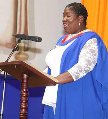 Image: Valedictorian Novenia Isaacs delivering her address.