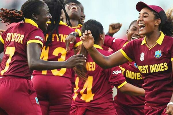 Image: Windies women celebrate the fall of another wicket. (PHOTO: AFP)