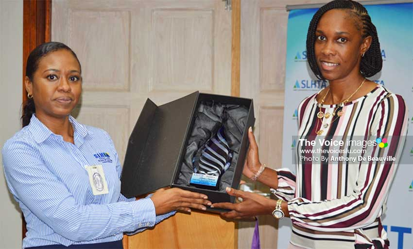 Image: (L-R) SLHTA Finance and Administration Officer, Yola St Jour presenting Levern Spencer with the Goodwill Ambassador Award. (PHOTO: Anthony De Beauville)