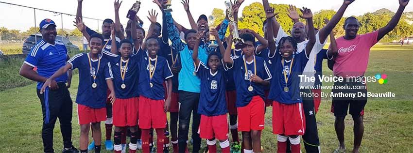 Image of a jubilant Flow Lancers FC Under 15 champion team. (PHOTO: Anthony De Beauville)
