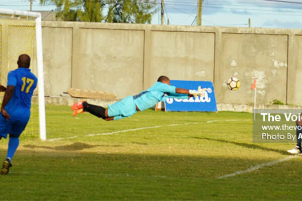 Image: In spite losing 3-2 to Central Vieux Fort, Caricom Maters (goalkeeper) Lawrence Octave came up with a brilliant save. (PHOTO: Anthony De Beauville)