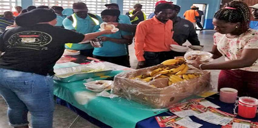 Image of employees of the Castries Constituency Council being treated to breakfast.