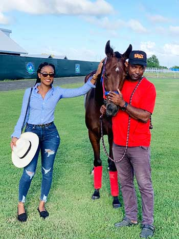 Image of Lily Thomas With Trainer Marvin Campbell And Queen Lily At The Royal Saint Lucia Turf Club.