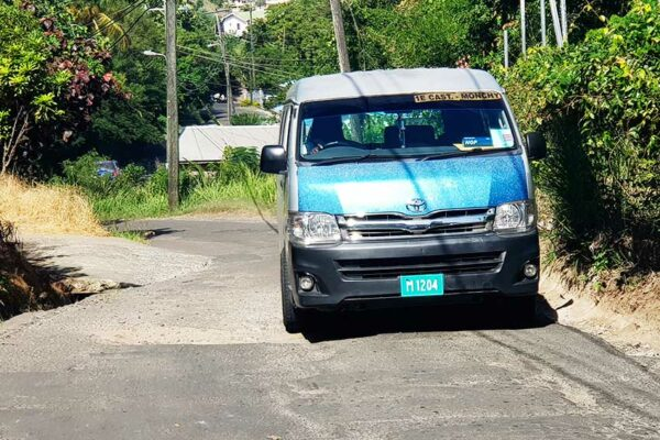 Image: Minibus operators are forced on to the side of the road to avoid a pothole.