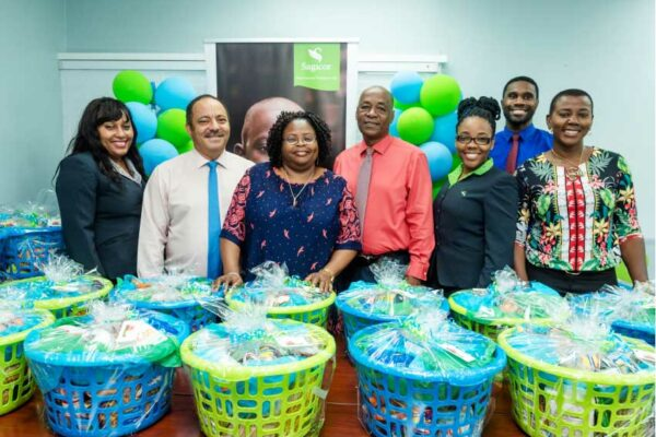 Image: Members of the Sagicor Team and Tanzia Toussaint of the Ministry of Equity, Social Justice, Local Government and Empowerment at the handover ceremony for Christmas hampers from Sagicor to the Ministry.