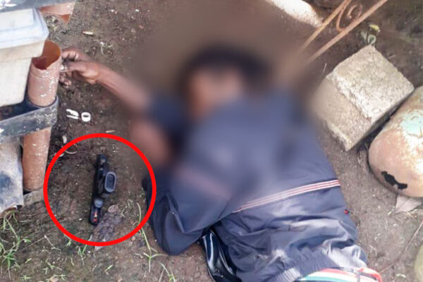 Image of Firearm next to victim.