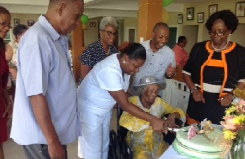 Image: Resident Martha's 102nd Birthday with then Governor General Dame Pearlette Louisy.