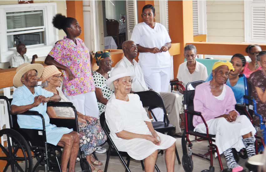 Image of residents with caregivers at the home.