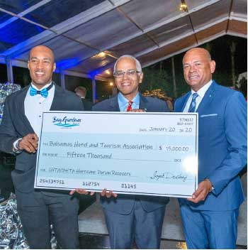 Image From Left: Sanovnik Destang, Executive Director of Bay Gardens Resorts; Bahamas Minister of Tourism and Aviation DionisioD'Aguilar; and Carlton Russell, President of the Bahamas Hotel and Tourism Association (BHTA) at the opening of Caribbean Travel Marketplace in The Bahamas.