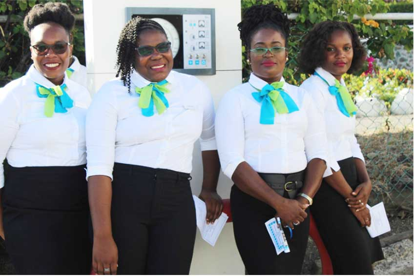 Image: Staff members of the Cooperative at Sunday's opening and blessing of their new building.