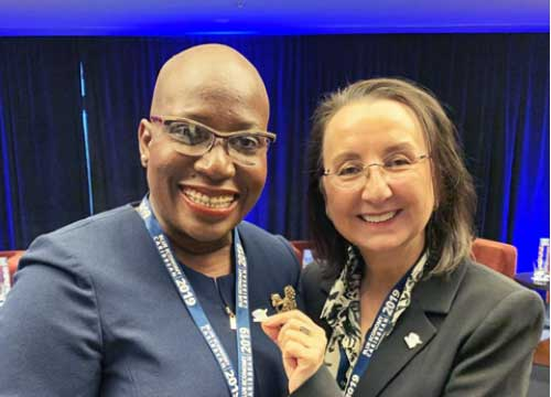 Image: Dr Gale Rigobert, St Lucia's Minister for Education, Innovation, Gender Relations and Sustainable Development (left), receives the Caribbean Challenge Initiative pin from CCI Special Envoy Karolin Troubetzkoy.