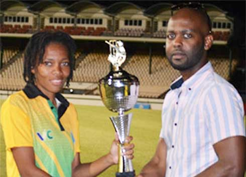 Image: Saint Vincent and the Grenadines captain EdelynTurtin receiving the 50 Overs championship trophy from CWI Vice President Shallow; Saint Lucia captain Ashlene Edward receiving the T20 Championship trophy from SLNCA President, Carol Henry. (PHOTO: Anthony De Beauville)