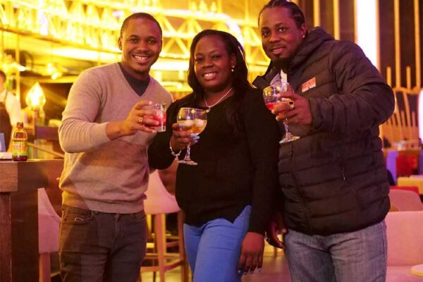 Image: (L-R) Magnum Tonic Wine's Brand Marketing Manager for the Region, Kamal Powell shares smiles and a cocktail with the lucky winner from St Lucia, Sherma Joseph and her guest, Ernilius Bennett.