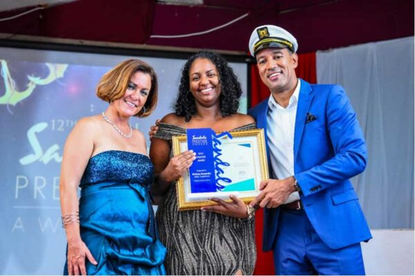 Image: Melissa Alexander, Sandals Halcyon Beach Resort's 2019 Team Member of the Year (center) flanked by General Manager 'The Admiral' Christopher Elliot (right) and Manager Martina Roth. (PHOTO: Courtesy Sandals Halcyon)