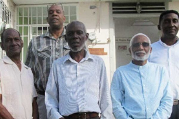 Image: Members of the steering committee instrumental in organising activities for the Year of the Bible, Pastor Sherwin Griffith, Pastor Waltrude Dantes, Pastor Andrew Sealy, Elder Robert Lee & President of the Gideons, Stephen Lambert. Beneath is Major Derek of the Salvation Army. Absent is Reverend Seth Ampadu of the Methodist Church.
