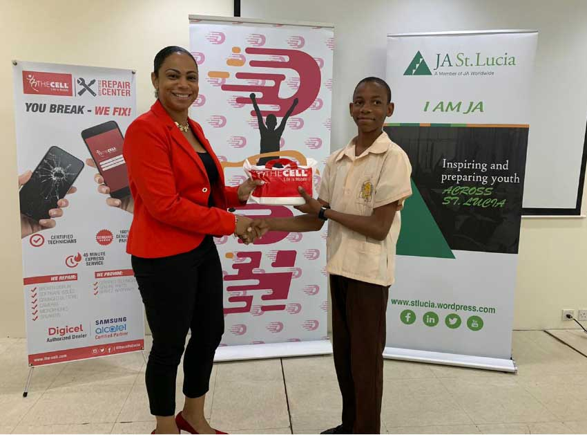 Image of Michael Stanislaus of CSS receiving prize from Cindy-Ann Gilbert, Sales and Marketing Manager of The Cell.
