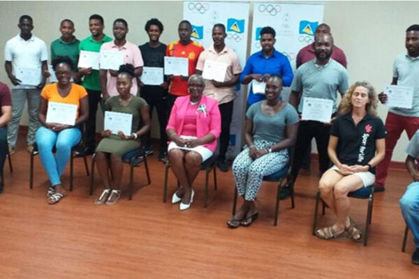 Image: CCCP P.E. teachers after having received their certificates pictured with SLOC Inc President Fortuna Belrose and Project Development Officer Andy Behl. (Photo: SLOC).