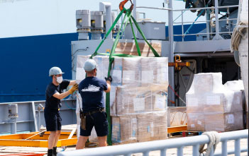 Image: Crew of the French Navy Ship Dumont d'Urville loading cargo from the CDEMA Integrated Regional Logistics Hub.
