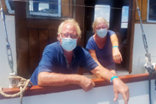 Image of Sailors donning their 'Sailing with the Caribbean Bubble' blue wristbands.