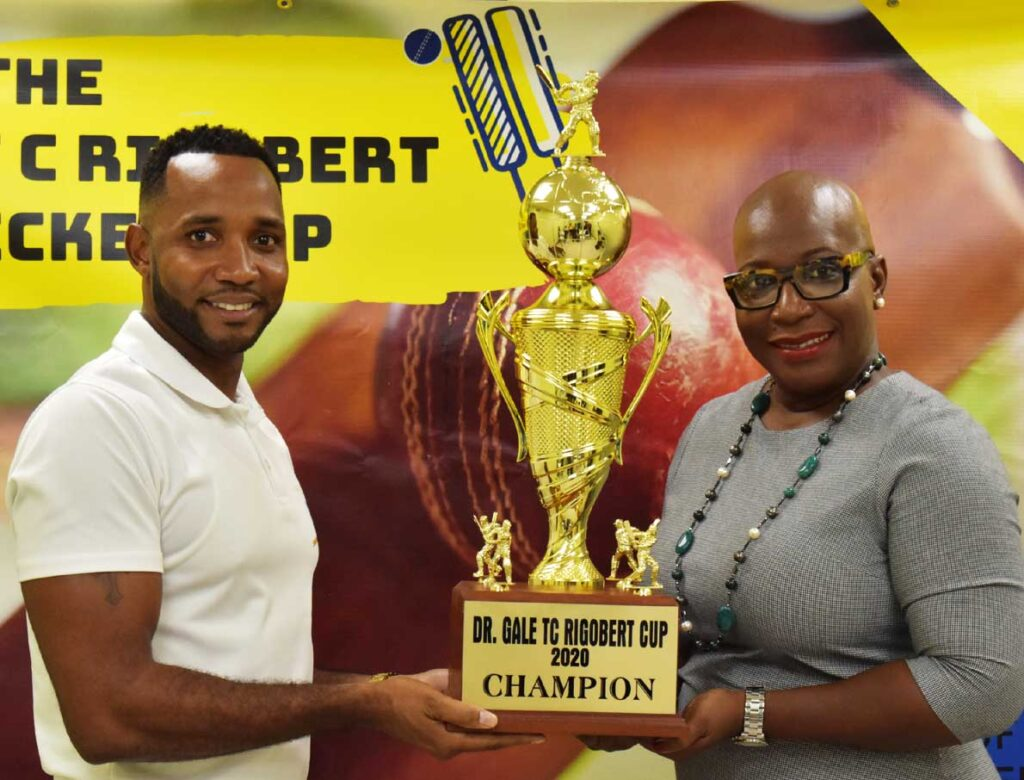 Image: (L-R) Tournament coordinator and former West Indies orthodox spinner, Garey Mathurin and Parliamentary representative for Micoud North, Dr. Gale Rigobert unveil the championship trophy. (PHOTO: Anthony De Beauville)