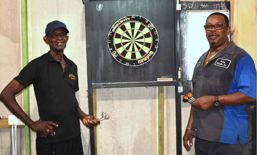 Image: (L-R) A photo moment for Gerald Cyril and close friend Denis 'Prio' Louis at the official Darts 501 Classic. (Photo: Anthony De Beauville)