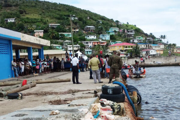 Image of curious onlookers converge on Dennery Fishing Port