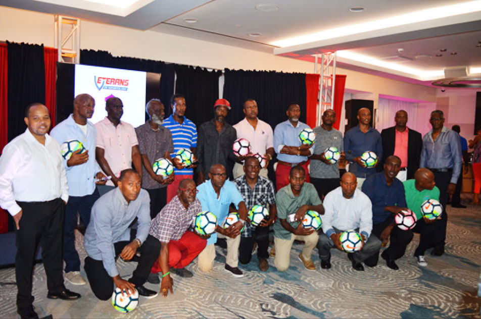 Image: A photo moment for Tournament Director, Garvin Niles standing first from left; CEO Alvin Malaykhan standing far right and representatives from the 19 participating teams. (PHOTO: Anthony De Beauville)