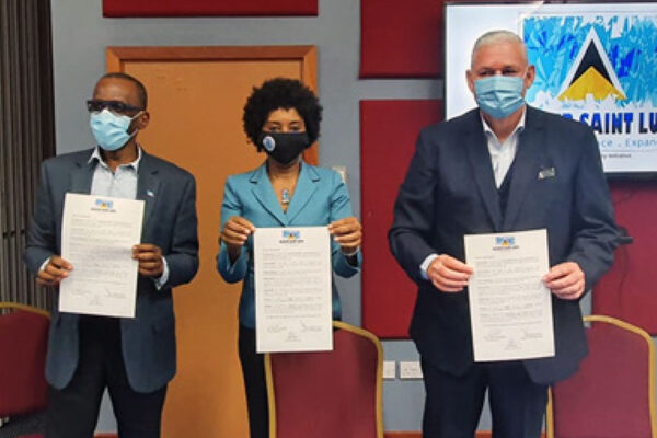 Image: From left to right, Opposition Leader Philip J. Pierre, Recover St. Lucia Chairperson Karen Peter and PM Allen Chastanet holding up signed copies of an MOU on the initiative.