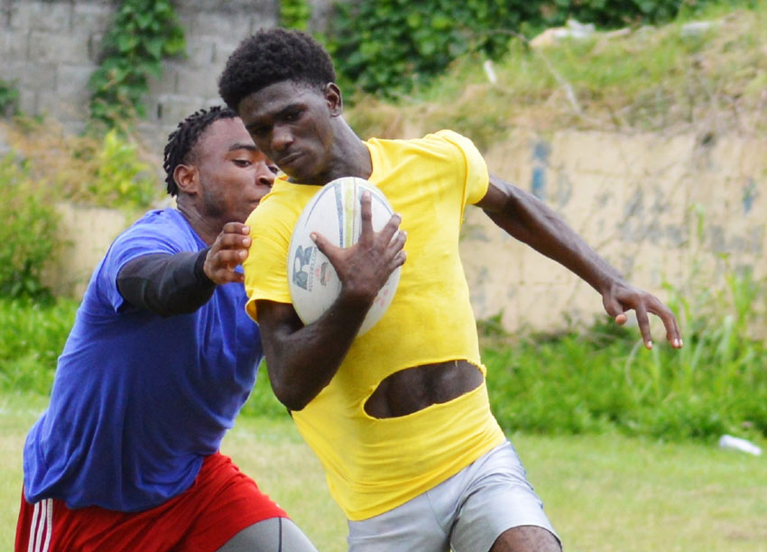 Image: (L-R) Despite Renegades came roaring in against Monchy Sharks, Samaki Jamie Daniel and Marvron Graham with ball in hand proved that they were all set for the challenge. (PHOTO: Anthony De Beauville)